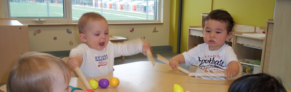 Babies playing on table
